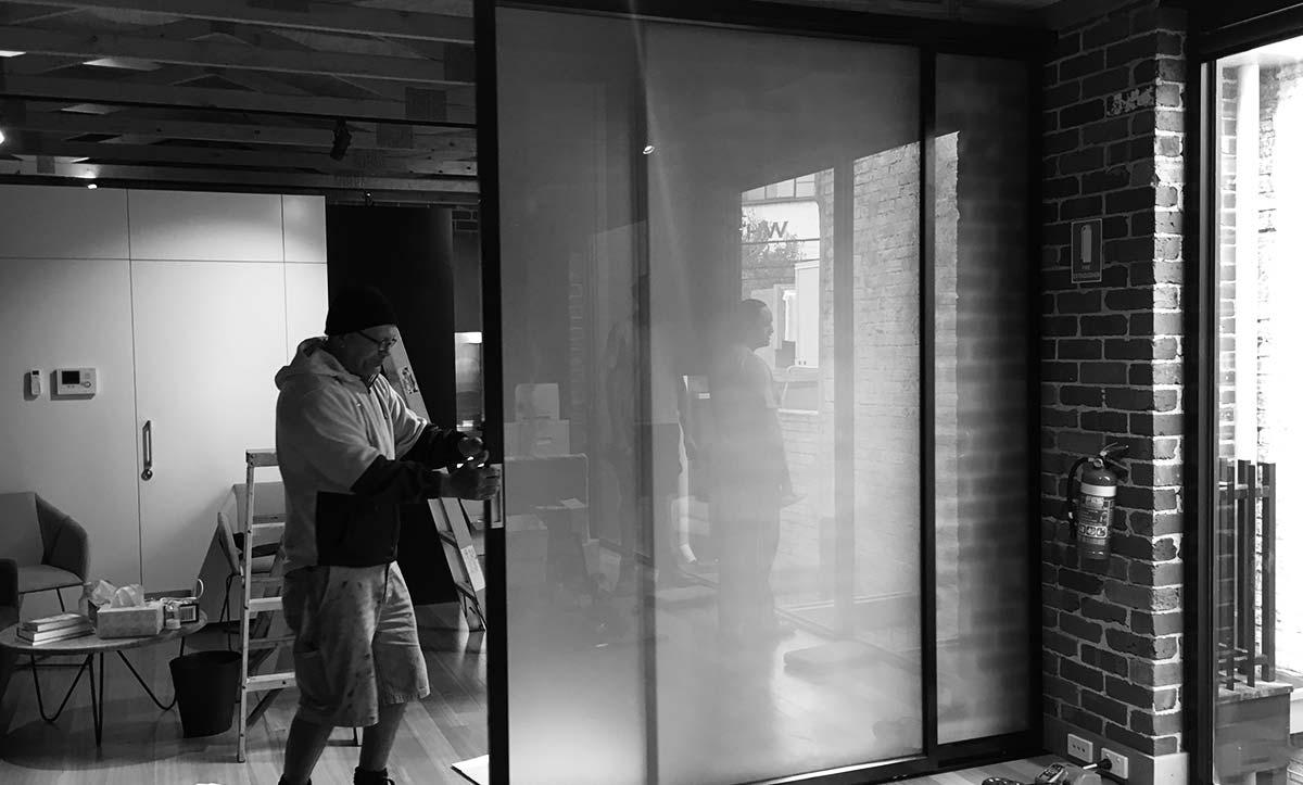 Nuline team installing sliding doors