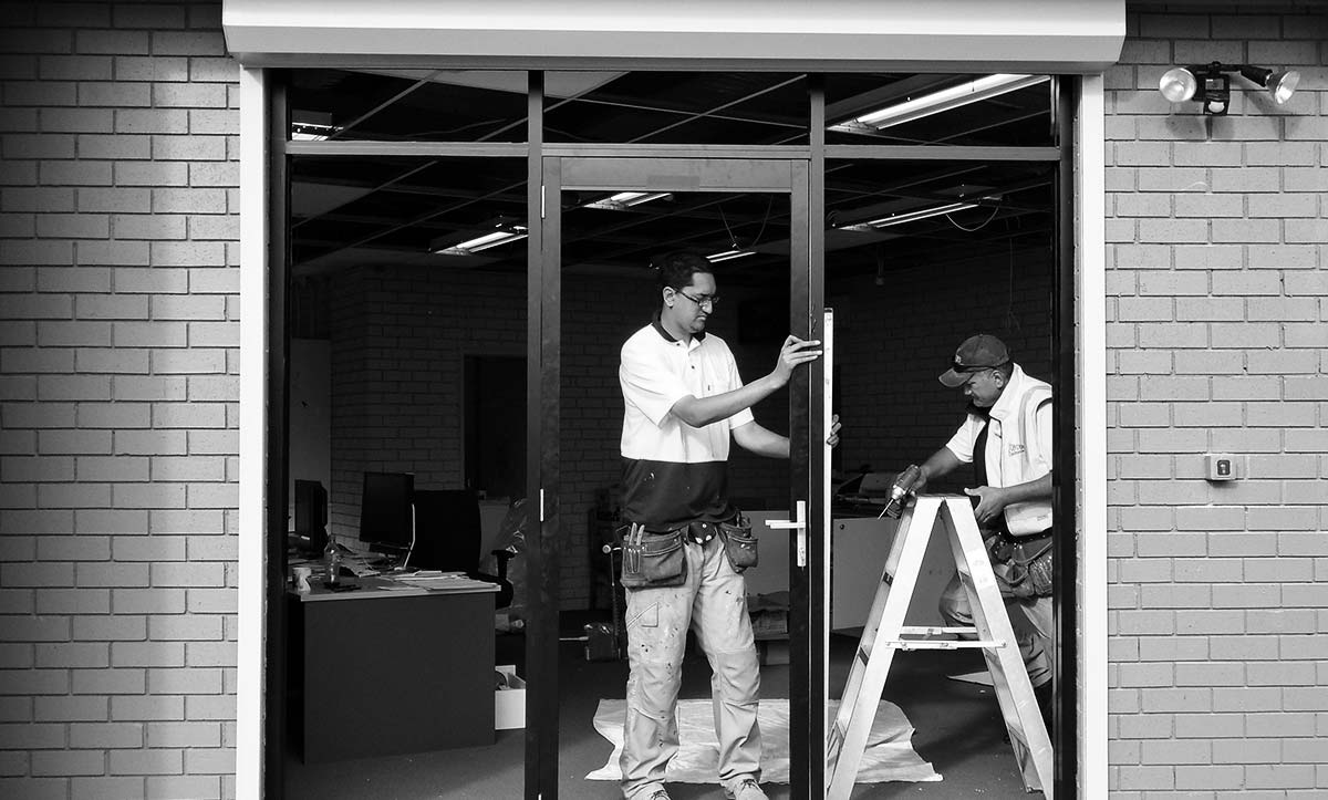 Nuline team installing aluminium glass door